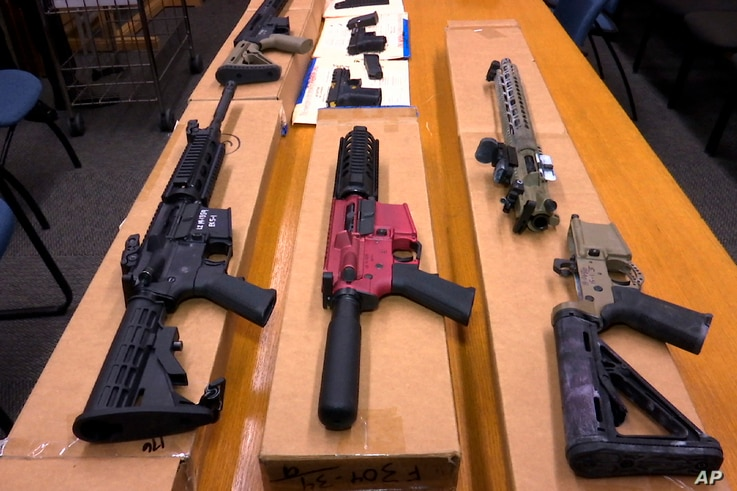 FILE - This Nov. 27, 2019, file photo shows 'ghost guns' on display at the headquarters of the San Francisco Police Department...