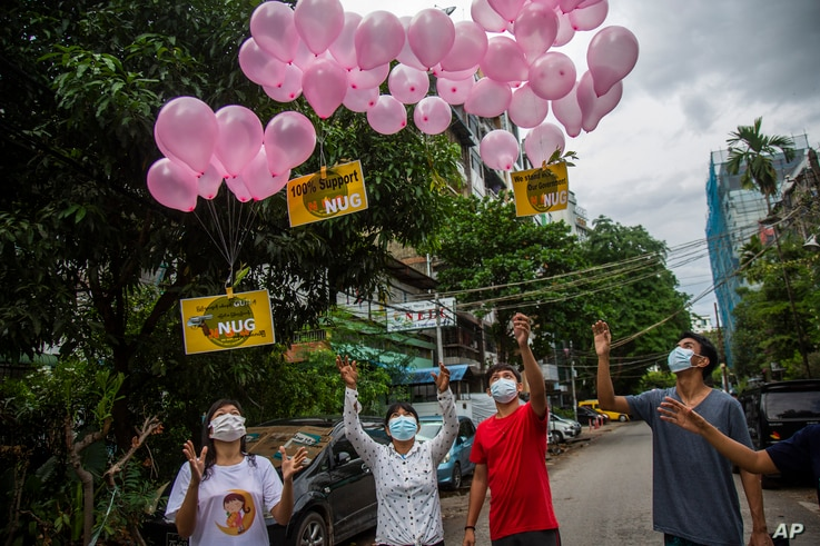 """Anti-coup protesters release balloons with posters reading """"We Support NUG"""" that stands for 'national unity government' during…"""