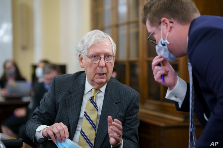 Senate Minority Leader Mitch McConnell, R-Ky., turns to an aide as the Senate Rules Committee holds a hearing on the 'For the...