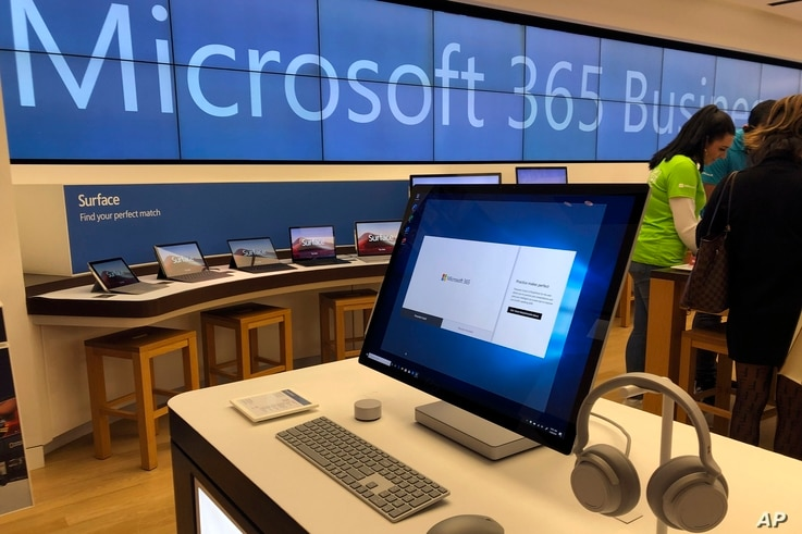 In this Tuesday, Jan. 28, 2020, photo a Microsoft computer is among items displayed at a Microsoft store in suburban Boston...