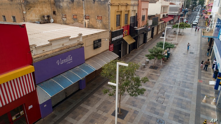 Stores are closed during a lockdown to stop the spread of the new coronavirus in downtown Ribeirao Preto, Sao Paulo state,…
