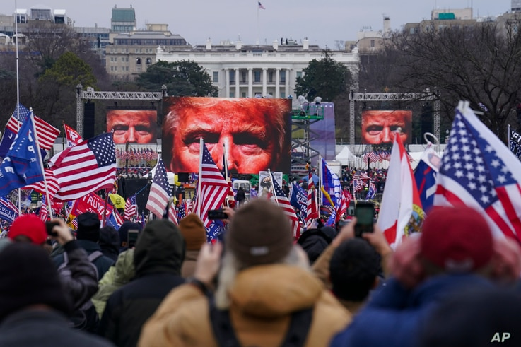 FILE - In this Jan. 6, 2021, file photo, Trump supporters participate in a rally in Washington. Far-right social media users…