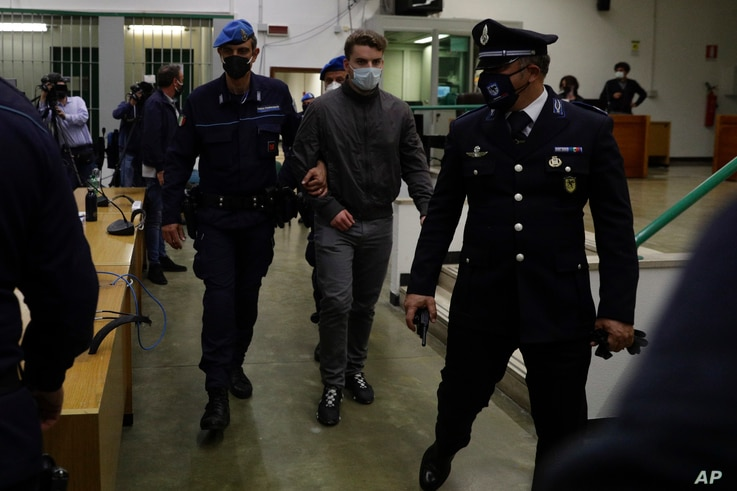 Gabriel Natale-Hjorth, center, is escorted by police officers during the trial for the slaying of an Italian plainclothes…