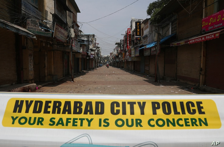 A signage is displayed at a closed market during a lockdown imposed to curb the spread of the coronavirus in Hyderabad, India,…