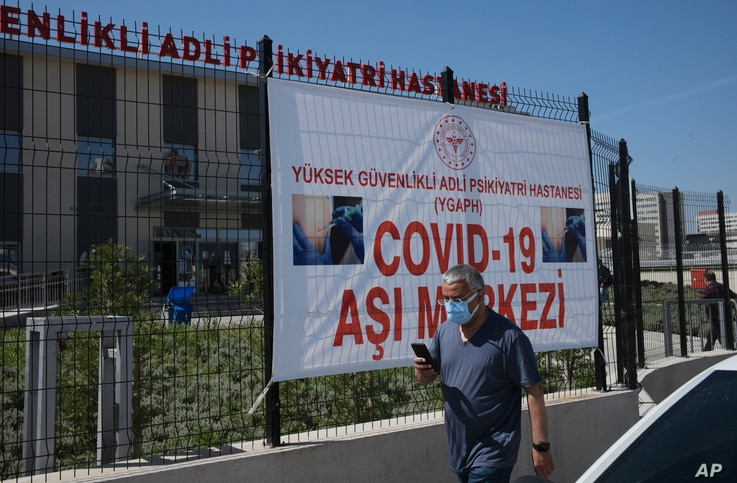 A man arrives to get a dose of Pfizer COVID-19 vaccine at a hospital, in Ankara, Turkey, Saturday, May 1, 2021. Turkish...