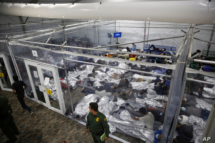 FILE - In this March 30, 2021, file photo, young minors lie inside a pod at the Donna Department of Homeland Security holding…
