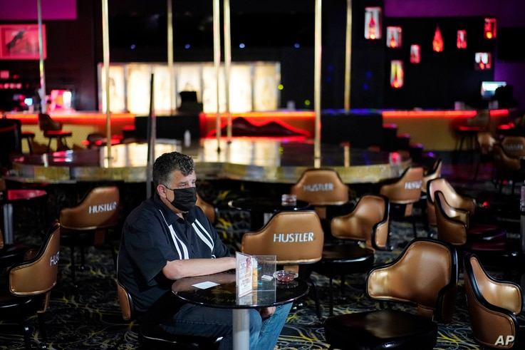 Jeff Cantrell waits at Larry Flint's Hustler Club strip club after getting his second dose of coronavirus vaccine Friday, May…
