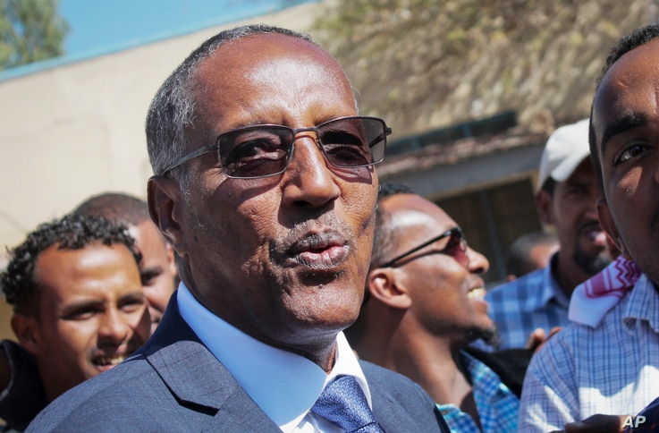 Ruling party candidate Muse Bihi Abdi speaks to the media after casting his vote in the presidential election in Hargeisa, in…