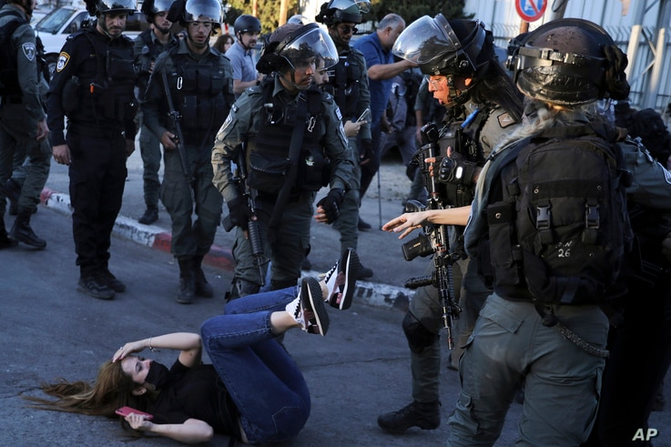 Israeli police scuffle with protesters in the Sheikh Jarrah neighborhood of east Jerusalem Saturday, May 15, 2021. The tensions…