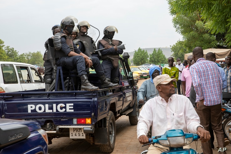 Malian police gather outside the Bourse du Travail where striking workers gathered to protest the arrest of President Bah N'Daw...