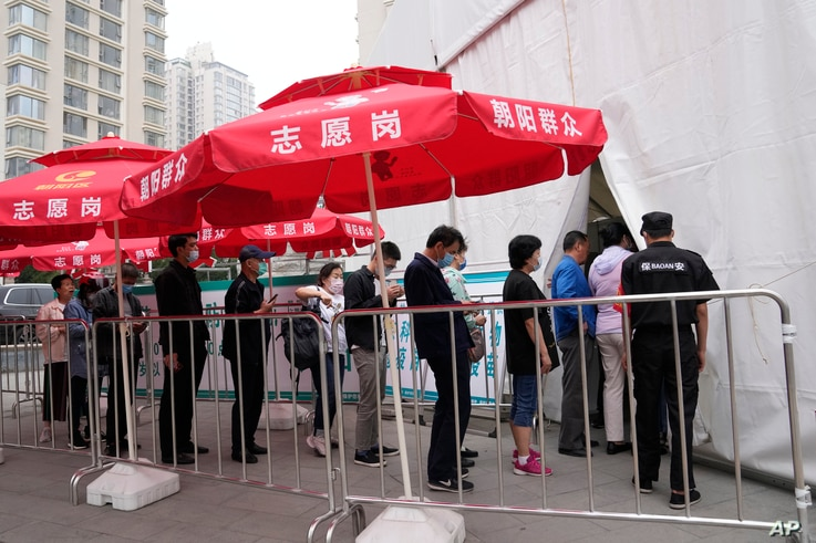 Residents line up outside a vaccination center in Beijing on Wednesday, June 2, 2021. After a slow start, China is now doing…