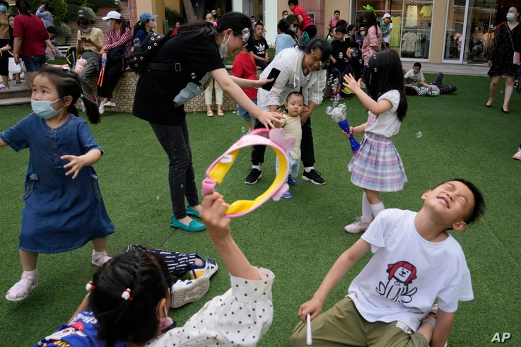 Children play during Children's Day at a mall in Beijing on Tuesday, June 1, 2021. China's ruling Communist Party said it will…