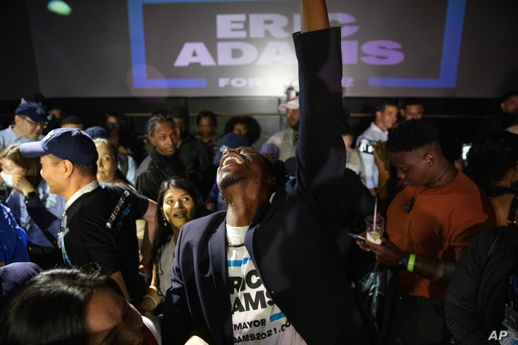 Supporters cheer during an election party for New York mayoral candidate Eric Adams, late Tuesday, June 22, 2021, in New York. …