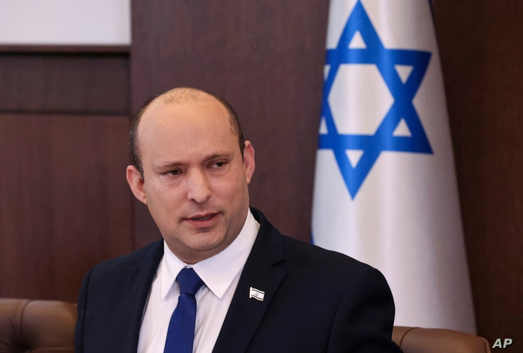 Israeli Prime Minister Naftali Bennett chairs the first weekly cabinet meeting of the new government in Jerusalem, Sunday, June...