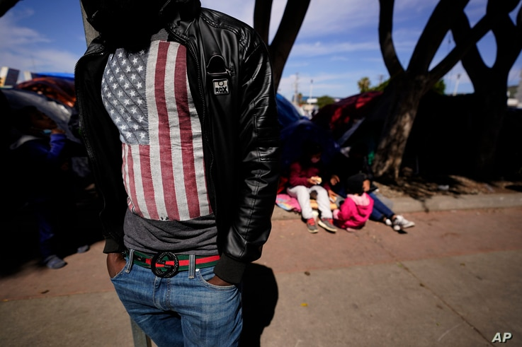 A migrant asylum seeker from Haiti waits at a makeshift camp of migrants at the border port of entry leading to the United…
