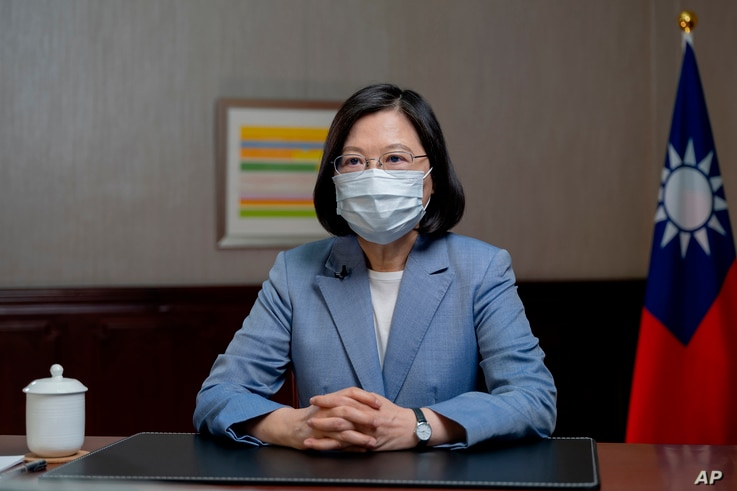 In this photo released by the Taiwan Presidential Office, Taiwan's President Tsai Ing-wen speaks at the presidential office in…