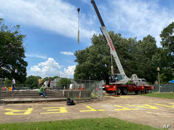 Workers dig up the remains of Confederate Gen. Nathan Bedford Forrest and his wife to move the bodies from Health Sciences Park...