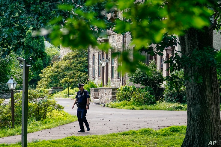 A policeman patrols past the home of Bill Cosby in Elkins Park, Pa., Wednesday, June 30, 2021. Pennsylvania's highest court has…