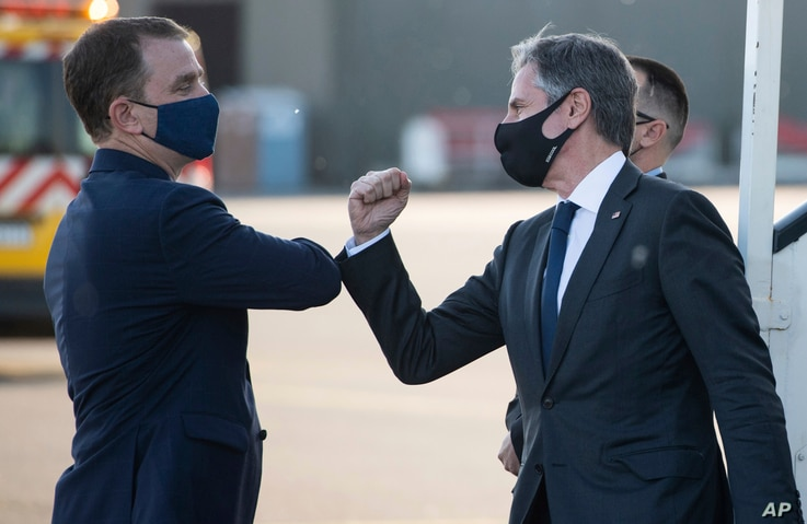 United States Secretary of State Antony Blinken, right, greets the U.S. Charge d'Affaires to Belgium Nicholas Berliner as he…