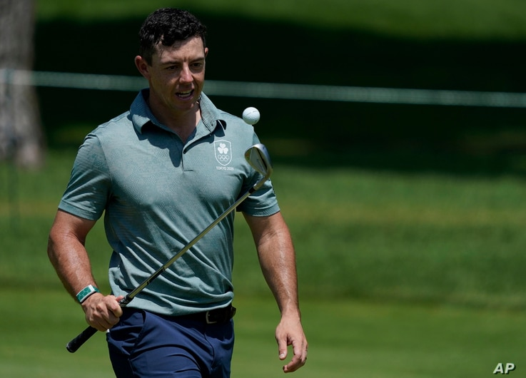 Ireland's Rory McIlroy practices with his chip during a practice session of the men's golf event at the 2020 Summer Olympics,...