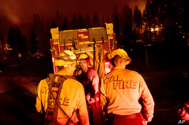 Firefighters work to stop the Sugar Fire, part of the Beckwourth Complex Fire, from spreading near Frenchman Lake in Plumas…