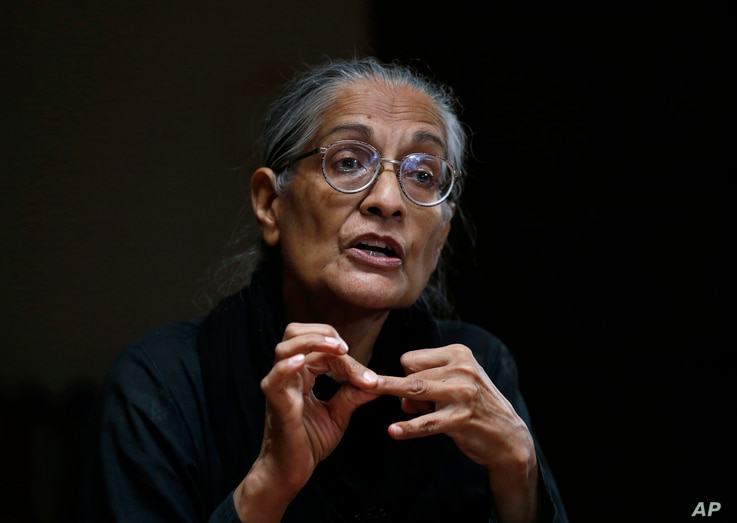 Pakistan's prominent rights activist Tahira Abdullah speaks about violence against women during an interview with The...