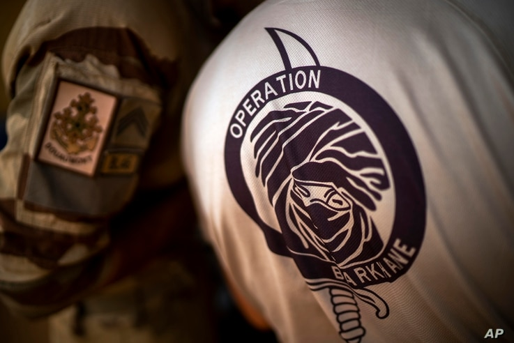 FILE- In this Wednesday June 9, 2021 file photo, French Barkhane force soldiers who wrapped up a four-month tour of duty in the…