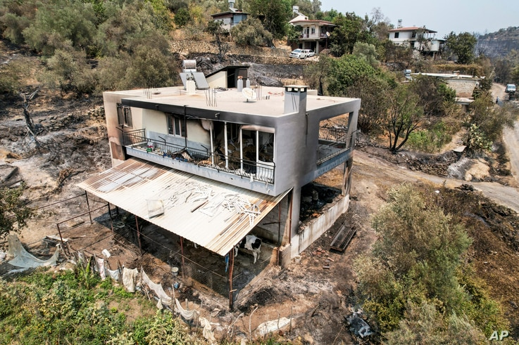 An aerial photo shows the destruction caused by wildfires near the Mediterranean coastal town of Manavgat, Antalya, Turkey,...