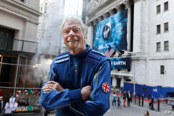 Sir Richard Branson, founder of Virgin Galactic, poses for a photo outside the New York Stock Exchange before his company's IPO…