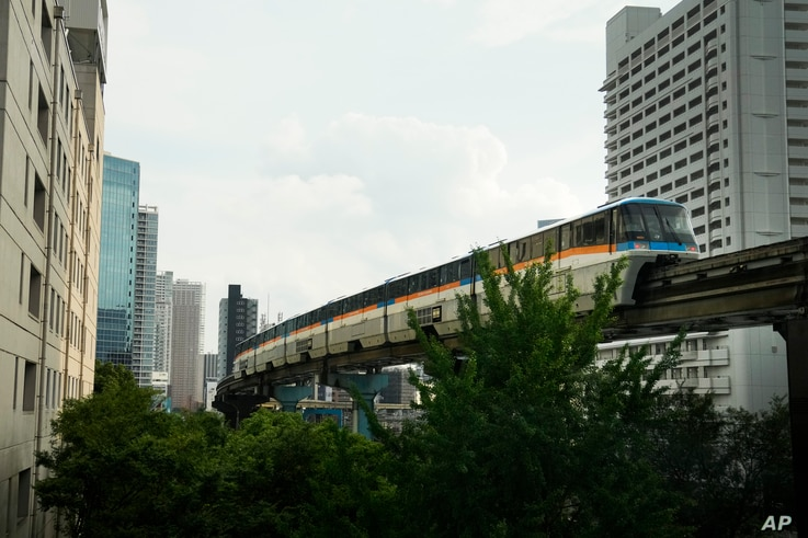 A monorail runs between buildings ahead of the 2020 Summer Olympics, Wednesday, July 14, 2021, in Tokyo. The state of emergency…