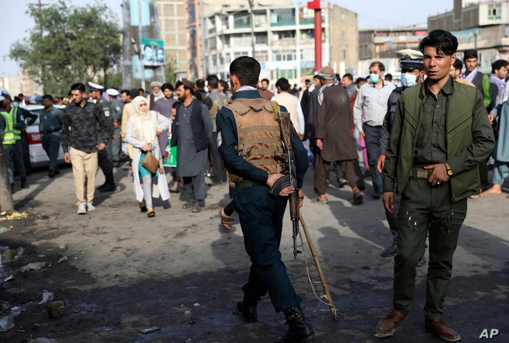 Afghan security personnel inspect the site of a deadly bomb explosion in Kabul, Afghanistan, Tuesday, July 13, 2021. The bomb…
