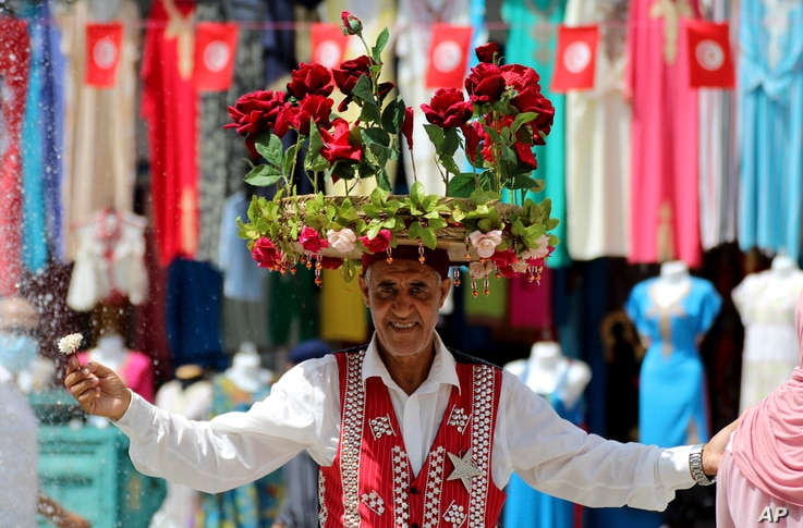 A flower seller is pictured at the old market in Tunis, Tunisia, Friday, July 30, 2021. Days of political turmoil in Tunisia...