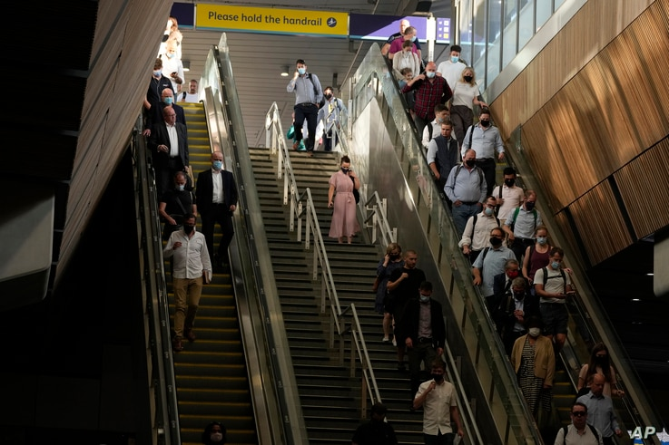 """On what some have called """"Freedom Day"""", marking the end of coronavirus restrictions in England, commuters take escalators and…"""