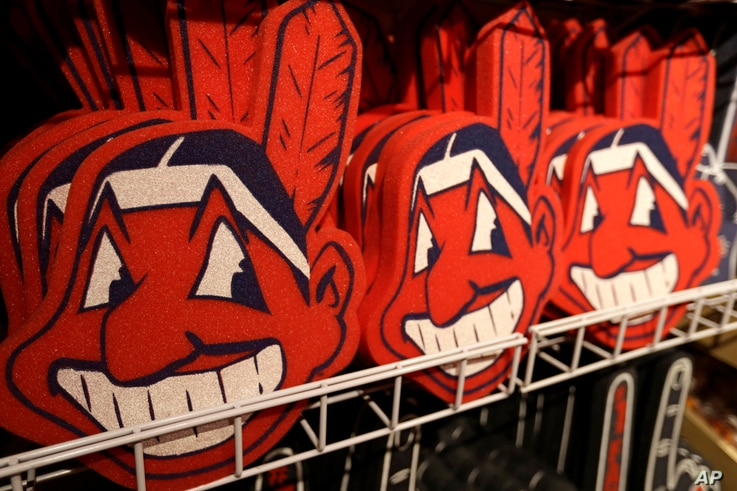 FILE - In this Jan. 29, 2018 file photo, foam images of the MLB baseball Cleveland Indians' mascot Chief Wahoo are displayed…