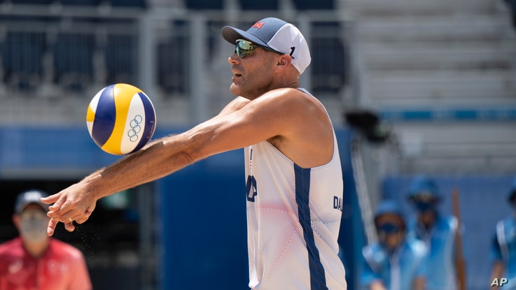 United States' Phil Dalhausser makes a dig at the 2020 Summer Olympics, Thursday, July 29, 2021, in Tokyo, Japan. (AP Photo...