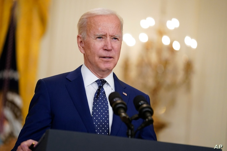 FILE - In this April 15, 2021, file photo, President Joe Biden speaks in the East Room of the White House in Washington. No…