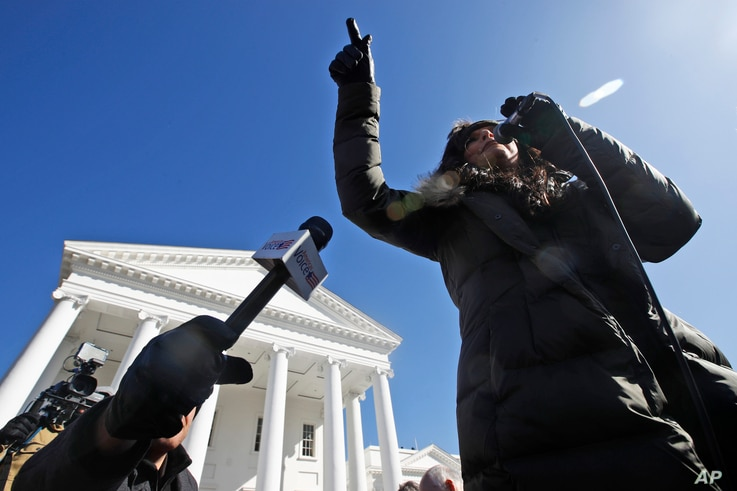 Jan Morgan, National Founder 2A Women, speaks during a pro gun rally in front of the Virginia State Capitol Monday, Jan. 20,…