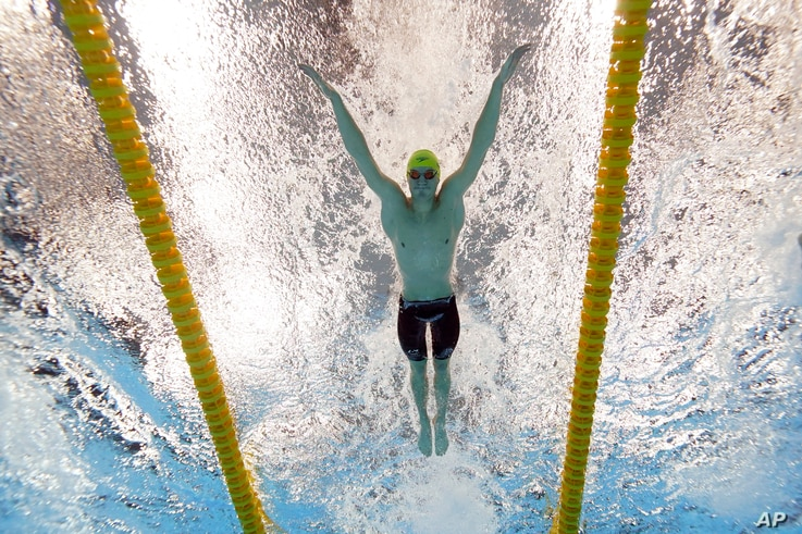 Australia's Brendon Smith swims to win the bronze medal in the 400-meter individual medley at the 2020 Summer Olympics, Sunday,...