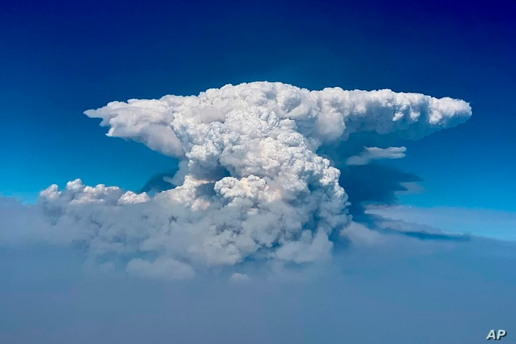 In this photo taken with a drone provided by the Bootleg Fire Incident Command, a pyrocumulus cloud, also known as a fire cloud...