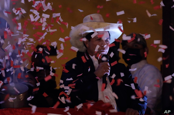 Pedro Castillo speaks to his supporters after election authorities declared him president-elect, during celebrations at his…