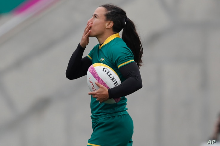 Brazil's Isadora Cerullo celebrates after scoring a try against Colombia during the women's rugby seven match for the bronze...