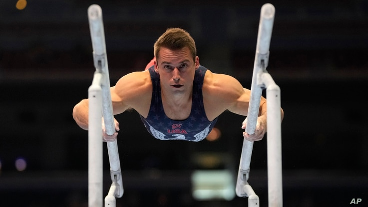 Sam Mikulak competes on the parallel bars during the men's U.S. Olympic Gymnastics Trials Saturday, June 26, 2021, in St. Louis...