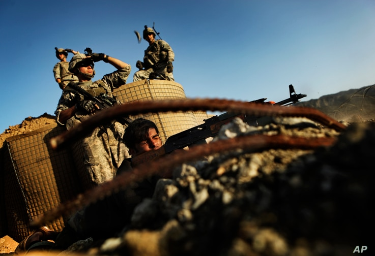 Sergeant Nesar Ahmad from the Afghan National Army, joined by the soldiers from the U.S. Army's 3rd Battalion, 509th Infantry…