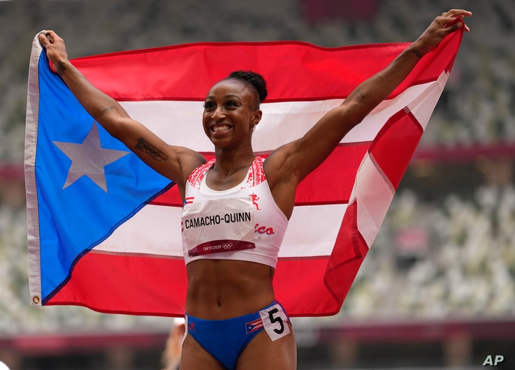 Jasmine Camacho-Quinn, of Puerto Rico celebrates after winning the gold in the women's 100-meters hurdles final at the 2020...