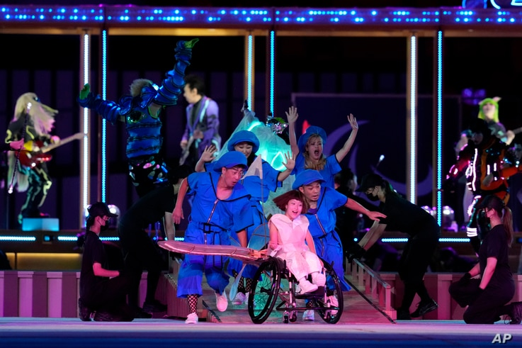 Entertainers perform during the opening ceremony for the 2020 Paralympics at the National Stadium in Tokyo, Tuesday, Aug. 24,…