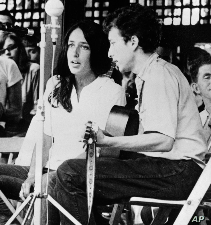 FILE - In this 1963 file photo, Joan Baez and Bob Dylan perform at the Newport Jazz Festival in Newport, R.I. Two years later,…