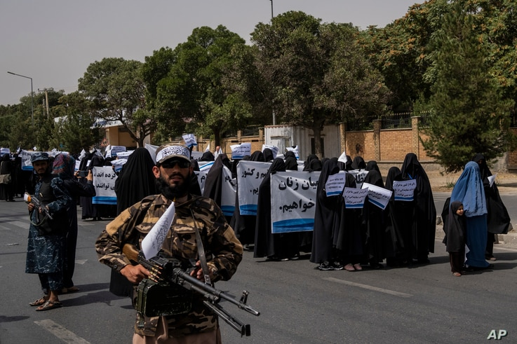 Women march in support of the Taliban government outside Kabul University, Afghanistan, on Saturday, Sept. 11, 2021. (AP Photo…