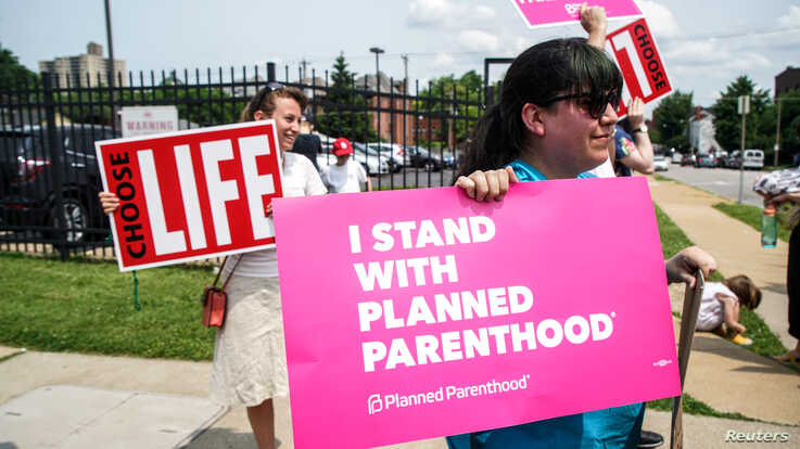 Protesters stand outside a Planned Parenthood clinic in St. Louis.