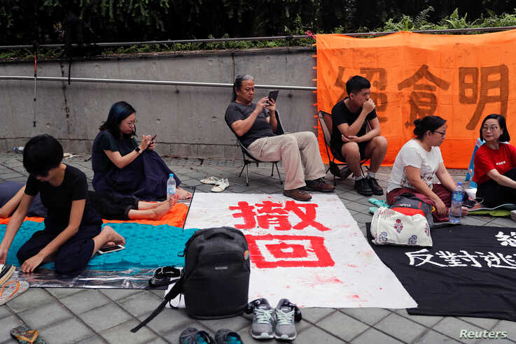 Protesters take part in a hunger strike during a demonstration against a proposed extradition bill in Hong Kong, China June 13, 2019.