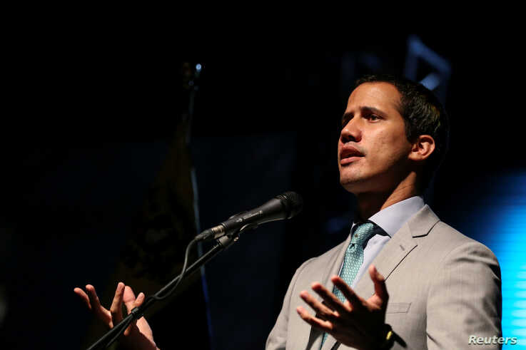 Venezuelan opposition leader Juan Guaido, who many nations have recognised as the country's rightful interim ruler, attends a meeting with representatives of Venezuela's private industrial sector in Caracas